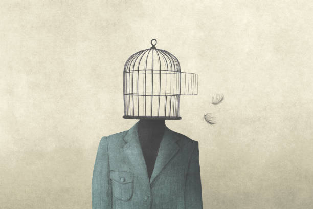 man with open birdcage over his head, surreal freedom concept stock photo