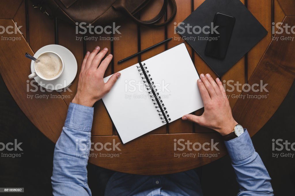 man with opened notepad stock photo