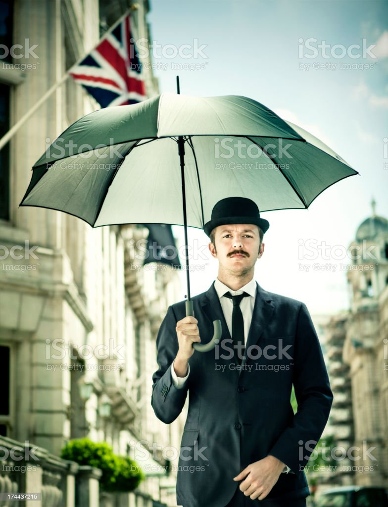 Man with opened umbrella stock photo