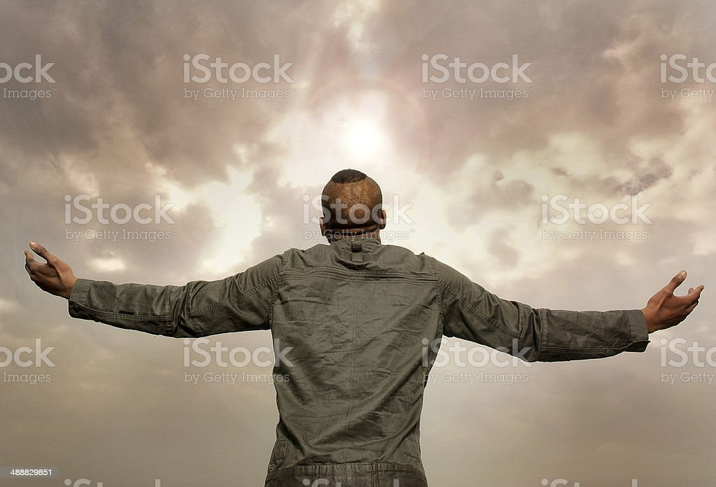 Man with outstretched arms looking at the sky royalty-free stock photo