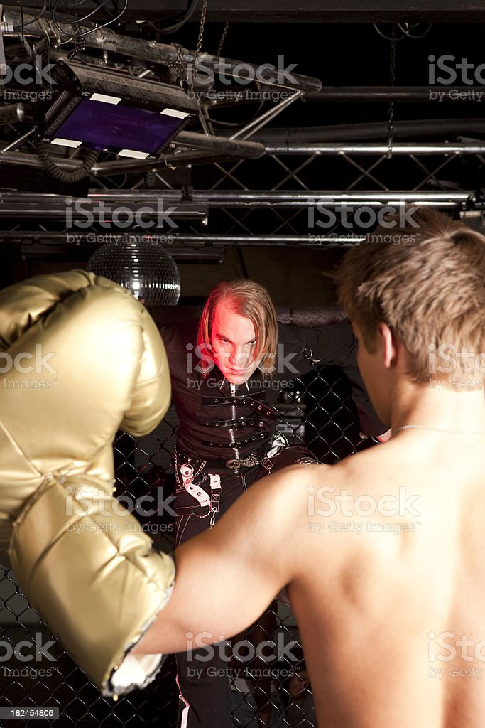 Man with oversized glove in front of punk royalty-free stock photo