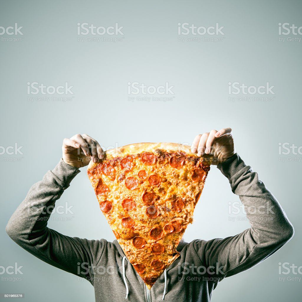 Man with Oversized Pizza Slice stock photo