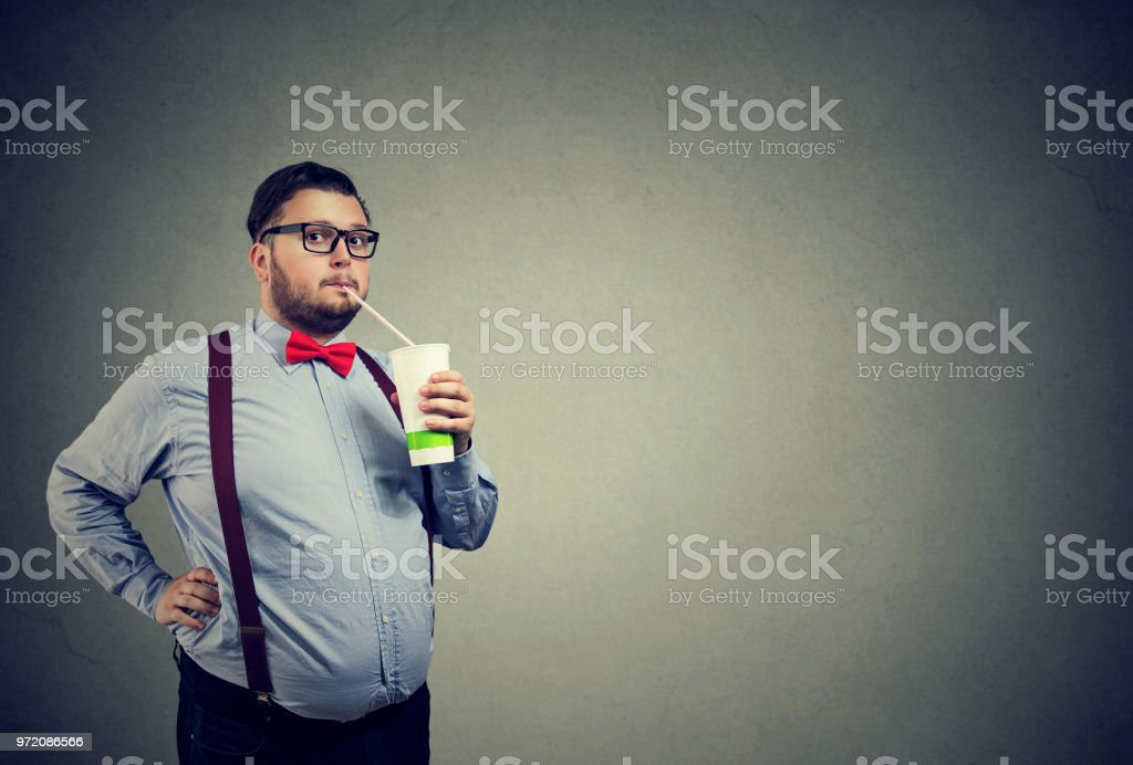 Man with overweight drinking sweet soda stock photo