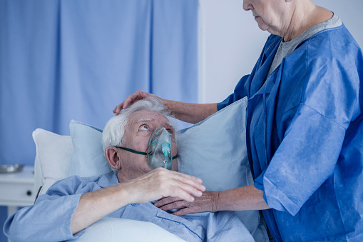 902077950 istock photo Man with oxygen mask 932299366