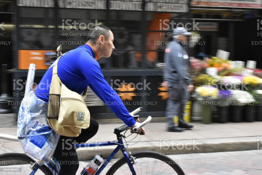 Man with Packages on a Bicycle, Boston stock photo