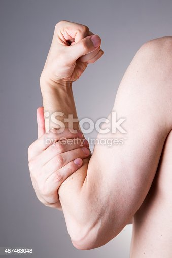 istock Man with pain in arm. Pain in the human body 487463048
