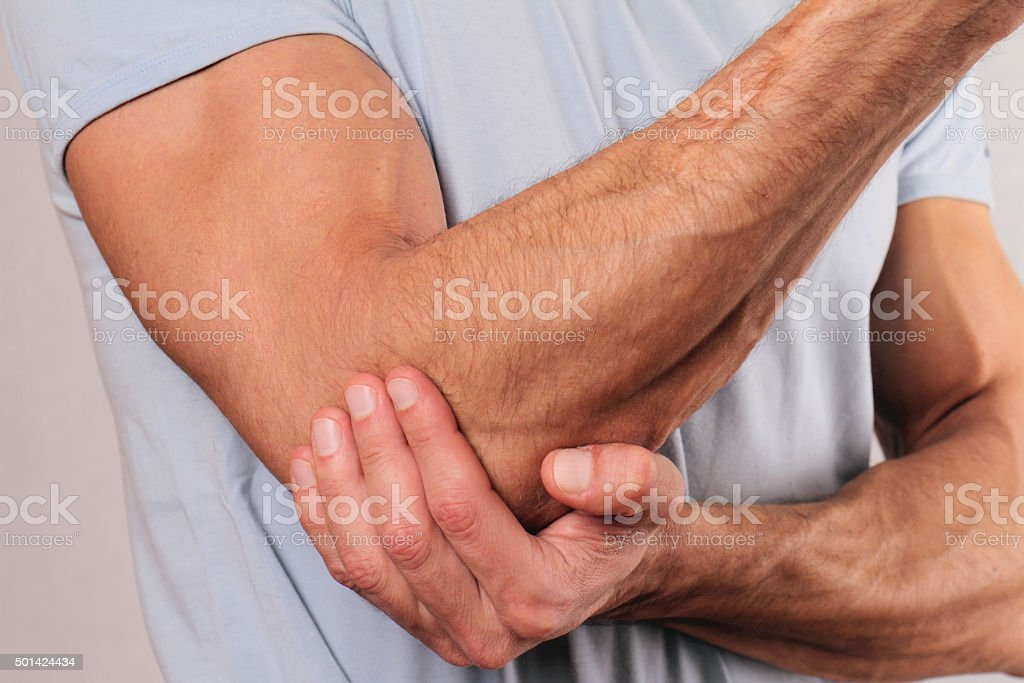 Man With Pain In Elbow. Pain relief concept bildbanksfoto