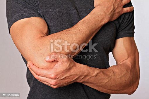 istock Man With Pain In Elbow. Pain relief concept 521297806
