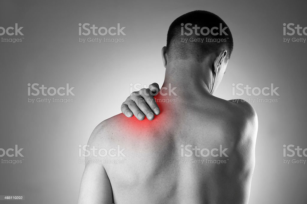 Man with pain in shoulder. Pain in the human body stock photo