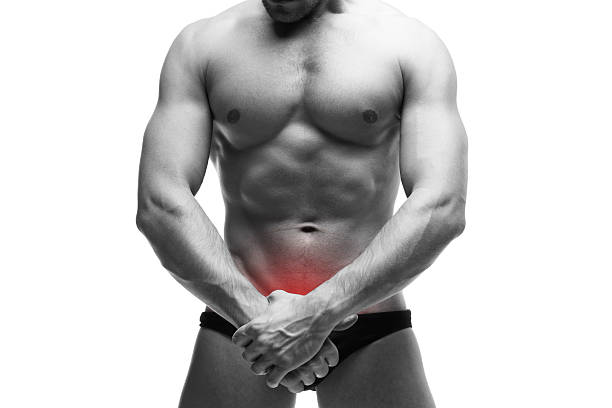Man with pain in the prostate stock photo