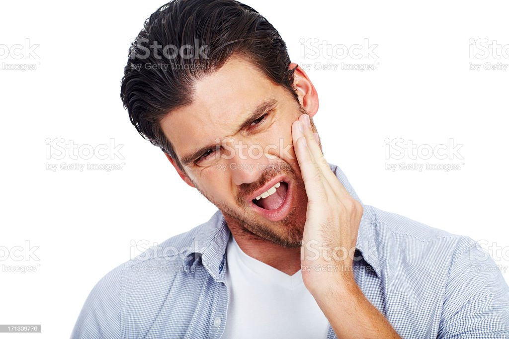 Man with painful expression holding one cheek stock photo