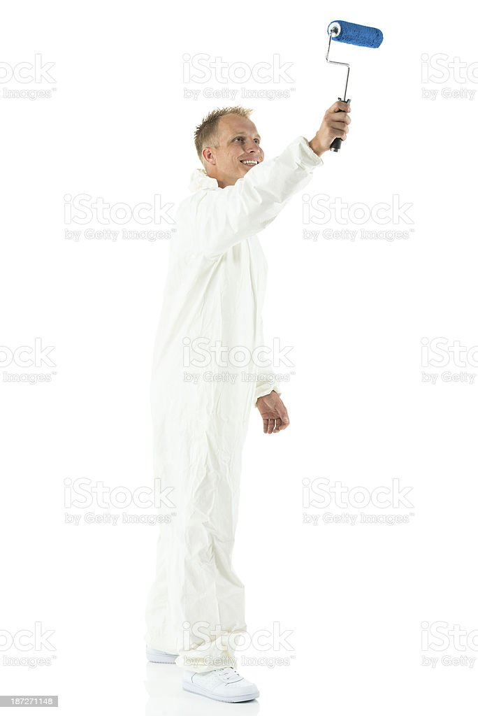 Man with paint roller stock photo
