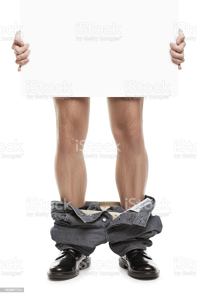 Man with pants down holding blank placard stock photo