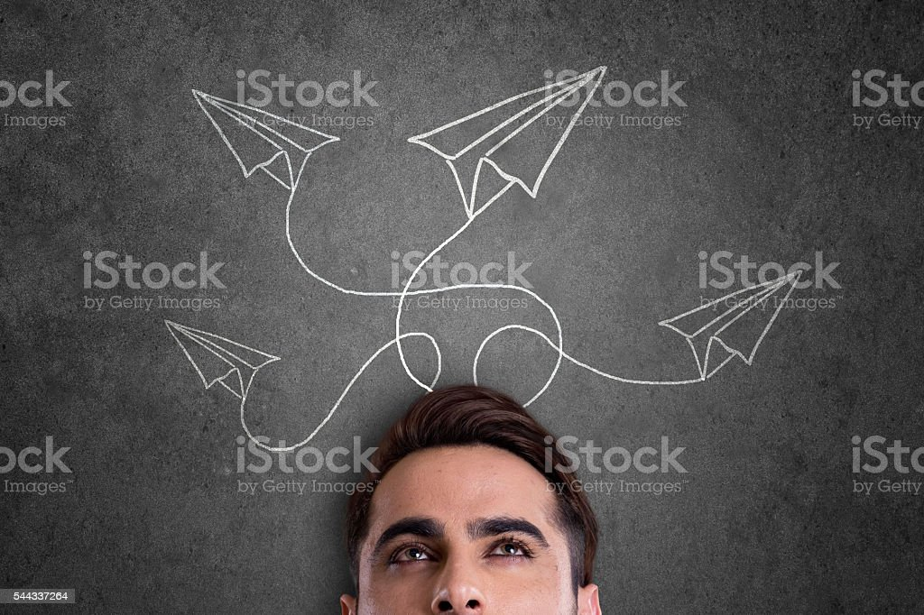 Man with paper airplane stock photo
