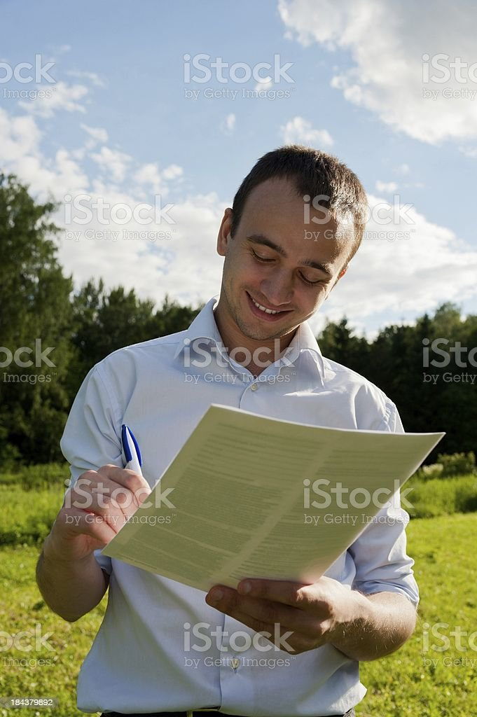 Man with paper and pen stock photo