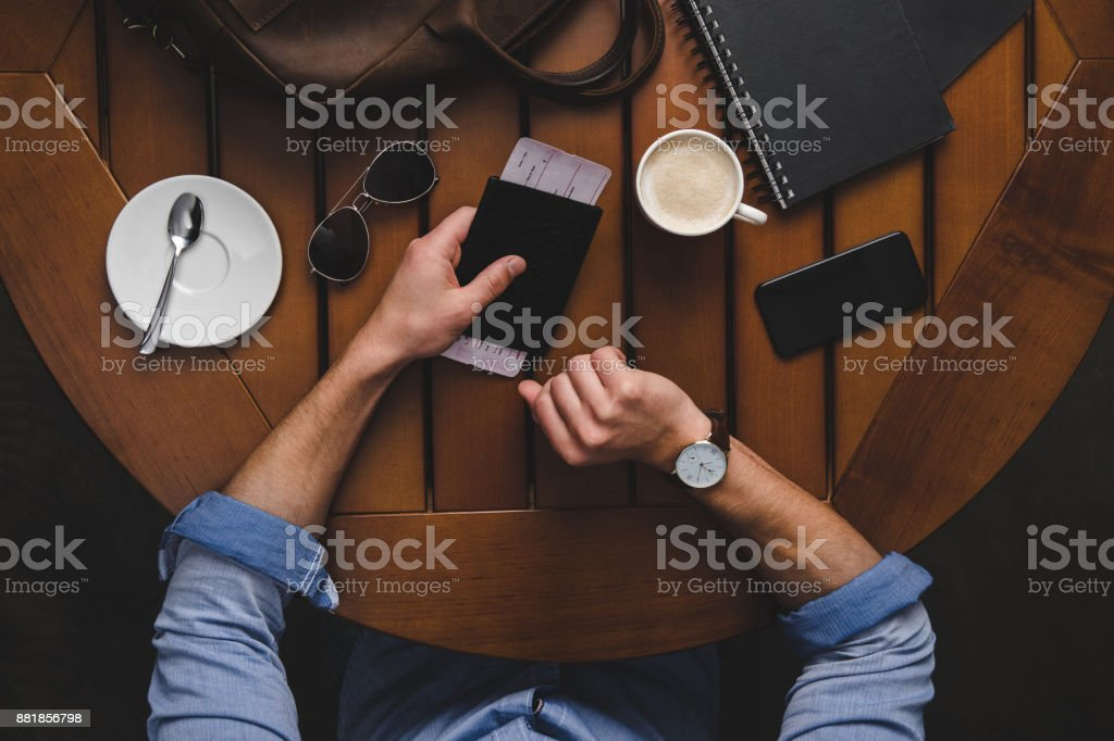 man with passport and air ticket stock photo