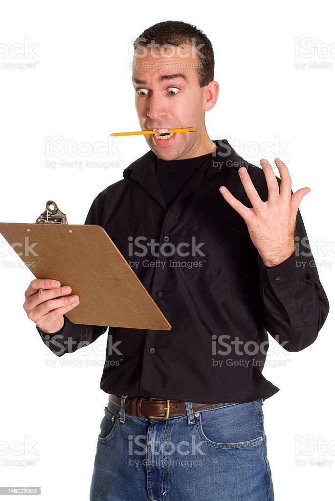 Man with pencil on mouth looking at clipboard with hand out royalty-free stock photo