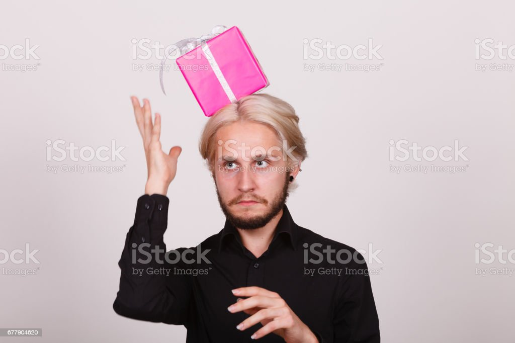 man with pink gift box on his head royalty-free stock photo