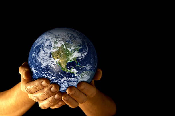 Man with planet earth in hands stock photo