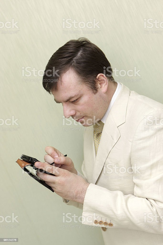 Man with pocket computer royalty-free stock photo
