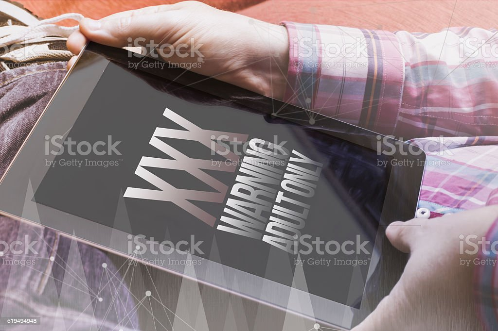 man with porn industry concept tablet on the sofa stock photo