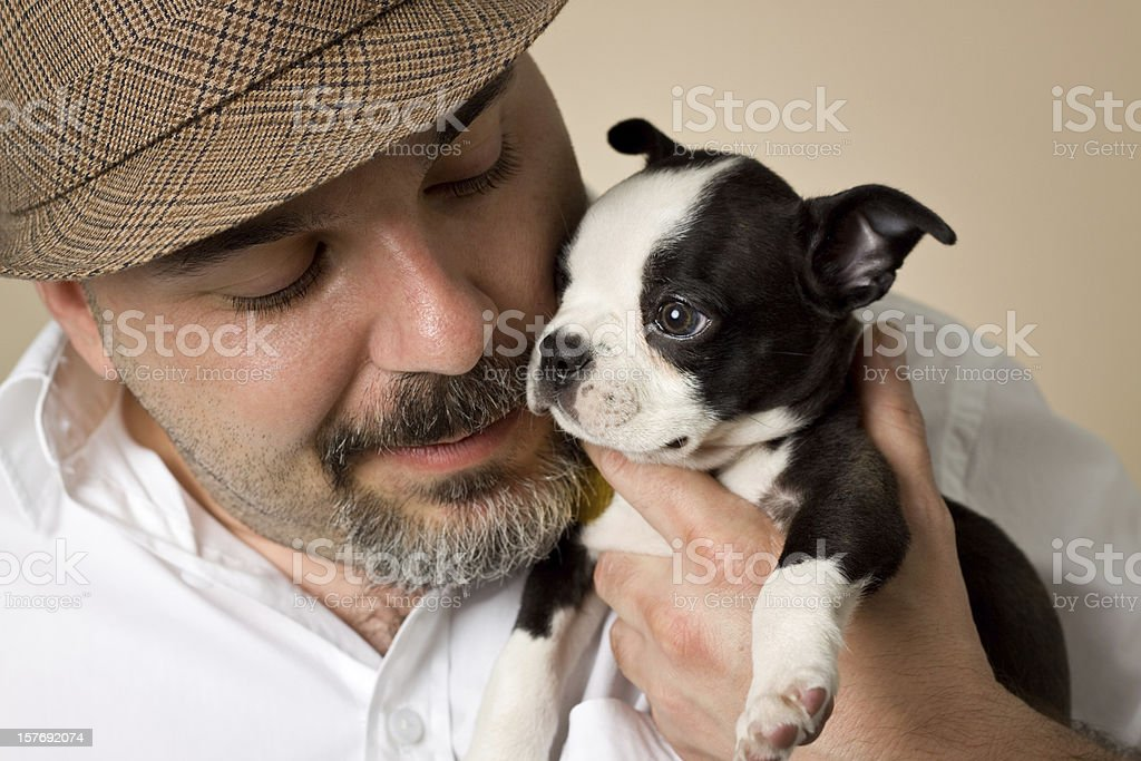 man with puppy royalty-free stock photo