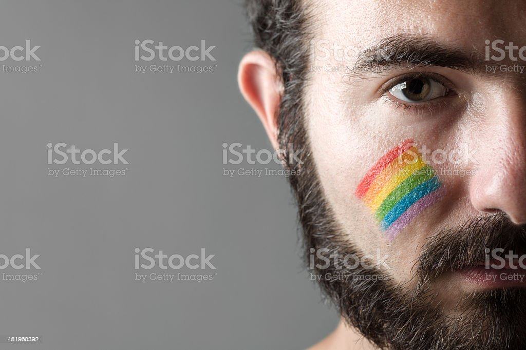 Man with Rainbow Paint stock photo