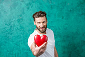 istock Man with red heart 639799878