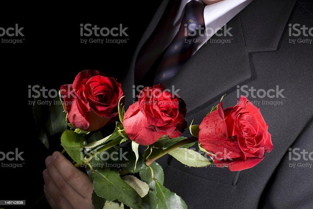 Mann mit roten Rosen – Foto