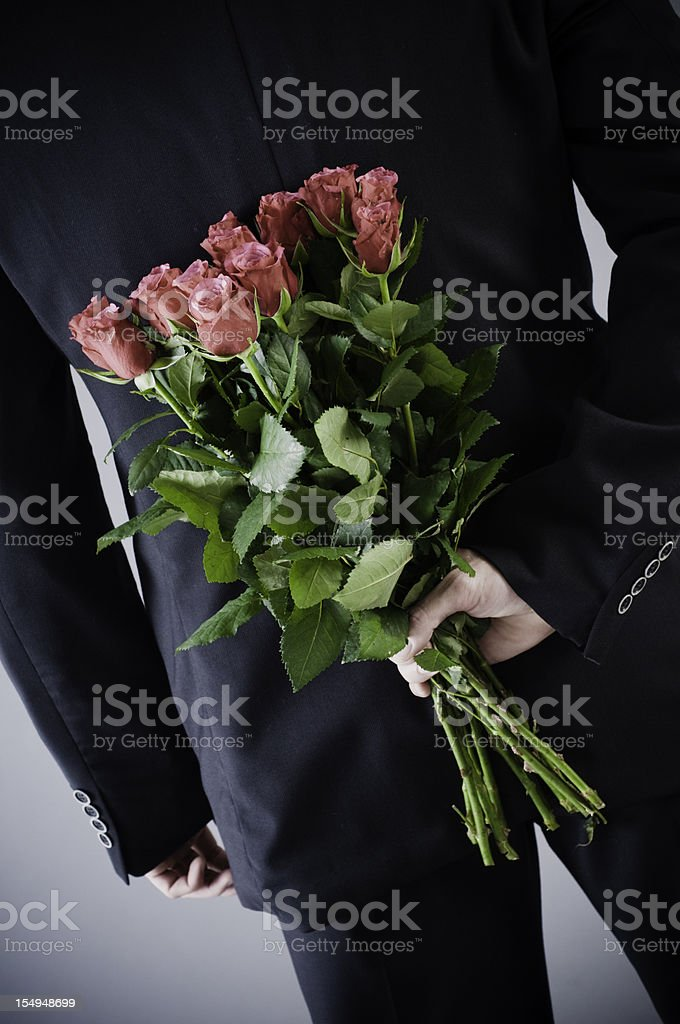 Man with red roses royalty-free stock photo
