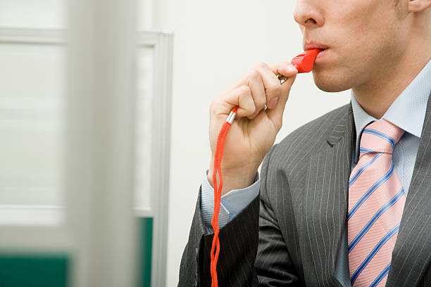 Man with Red Whistle in Office stock photo