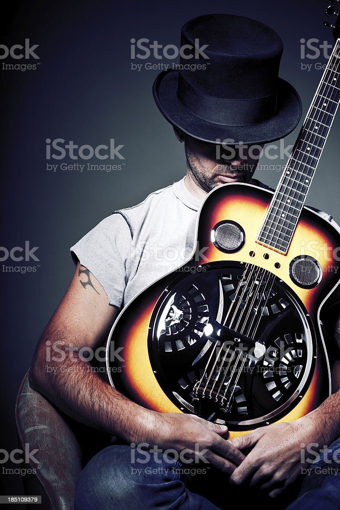 Man with resonator guitar stock photo