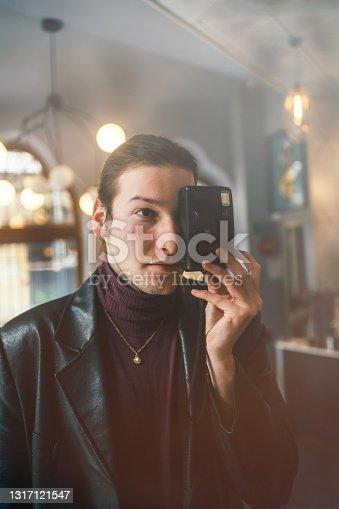 istock man with retro photocamera 1317121547