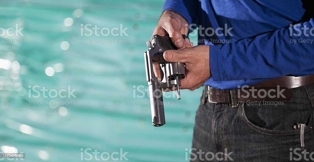 Man with revolver stock photo