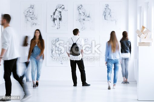 istock Man with rucksack in gallery 859639314