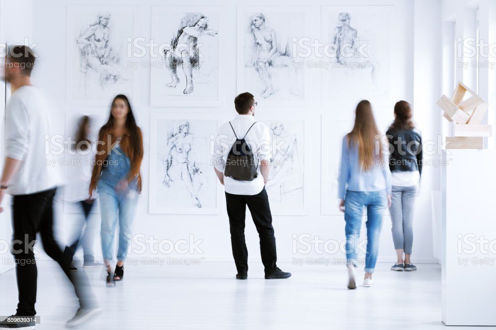 Man with rucksack in gallery stock photo