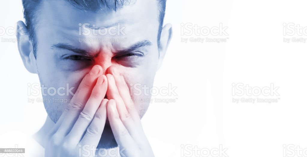 man with runny nose on white background, in blue toning, ill with laryngitis stock photo