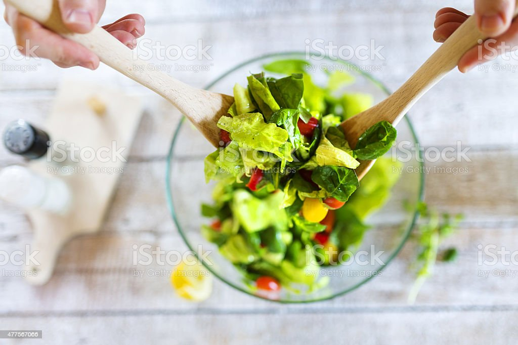 Man with salad stock photo