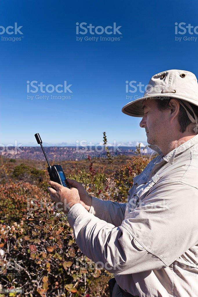 Man with satellite phone stock photo