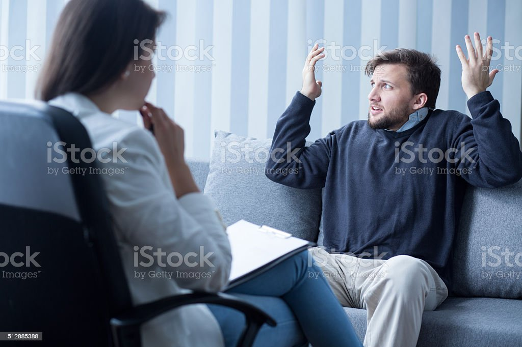 Man with schizophrenia during psychotherapy stock photo