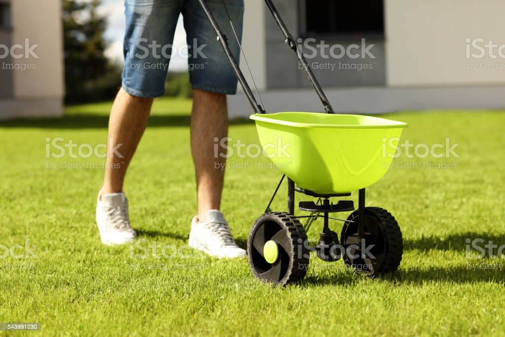 Man with seeder stock photo