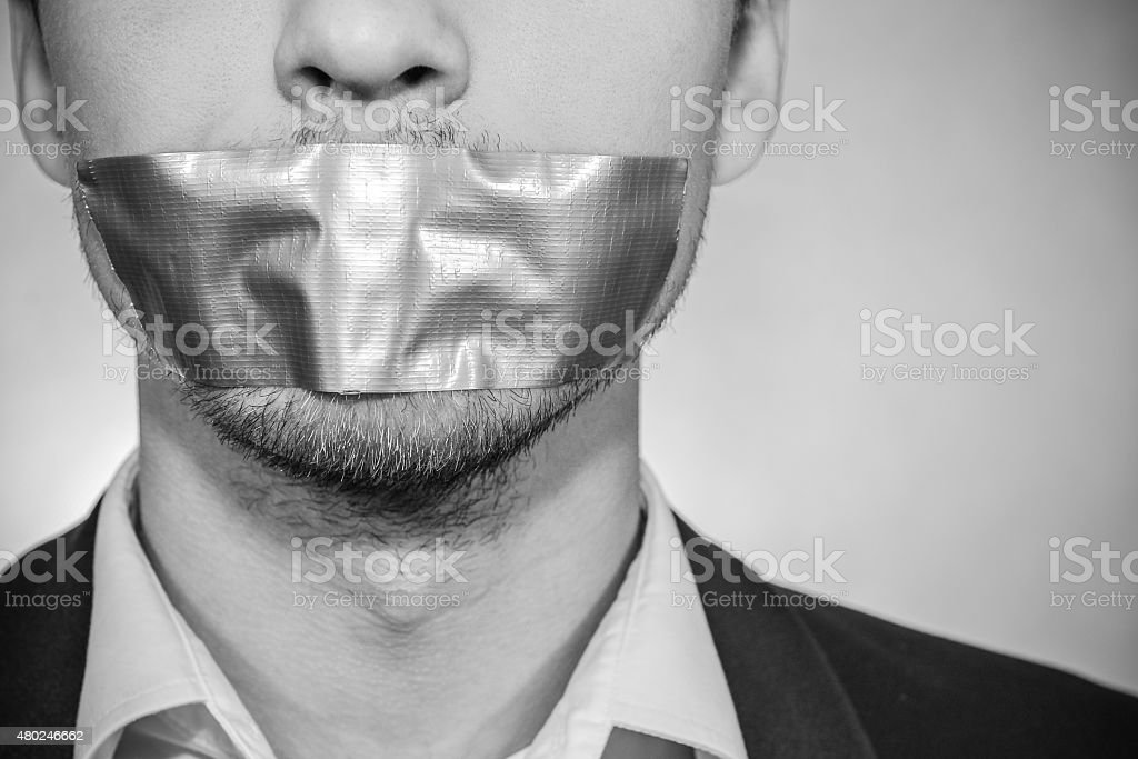 Man with sellotape stock photo