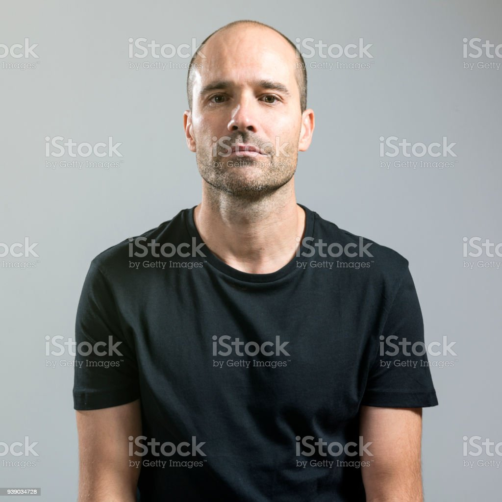 Man with serious face stock photo