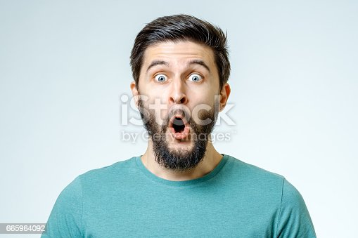 istock Man with shocked, amazed expression isolated on gray background 665964092