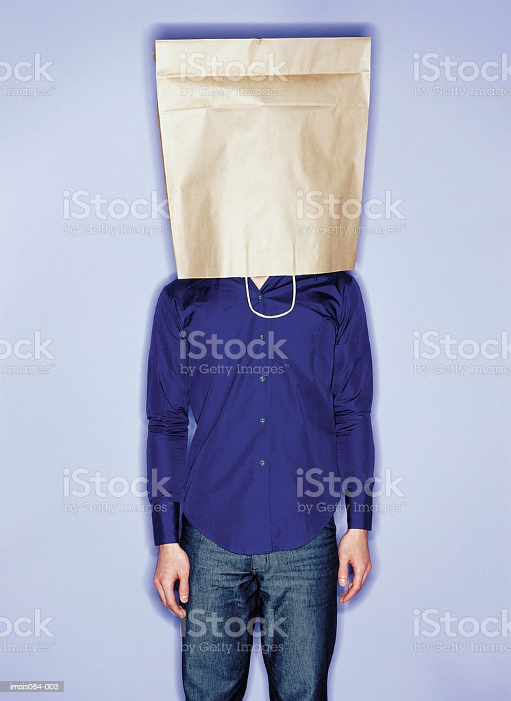 Man with shopping bag on head royalty-free stock photo