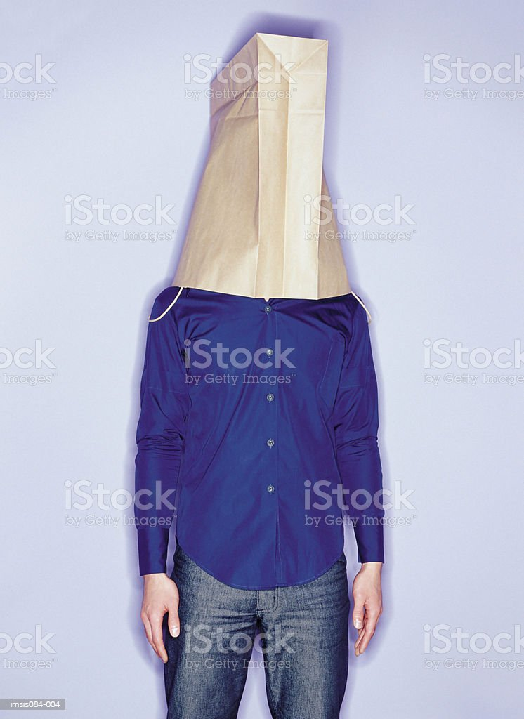 Man with shopping bag on head foto royalty-free