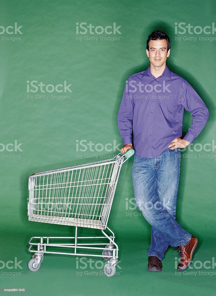 Man with shopping trolley royalty free stockfoto