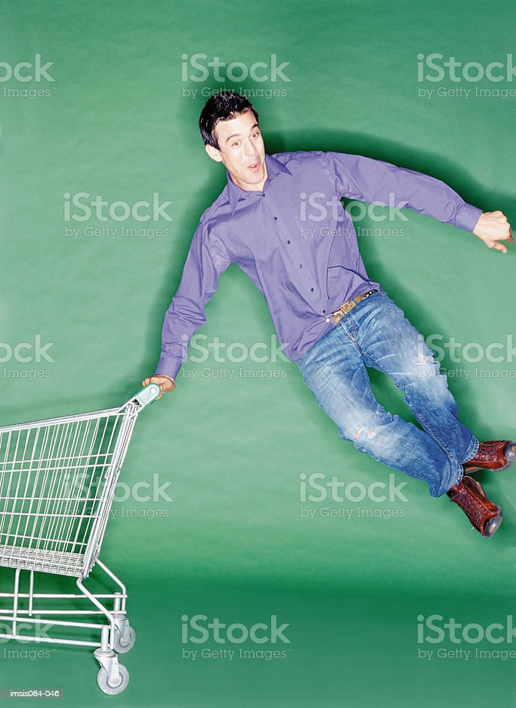 Man with shopping trolley 免版稅 stock photo