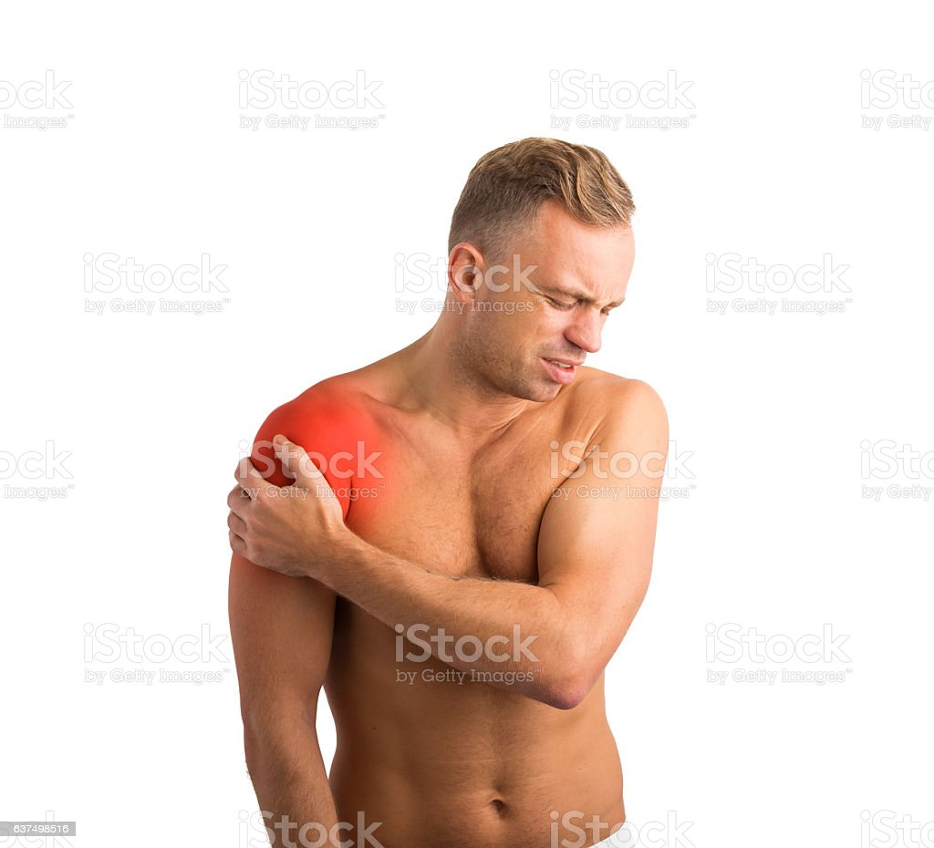 Man with shoulder pain holding his hand to it stock photo