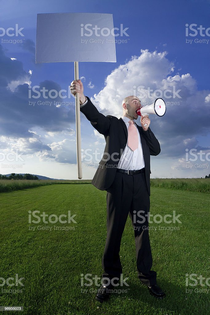 Man with sign and megaphone royalty-free stock photo